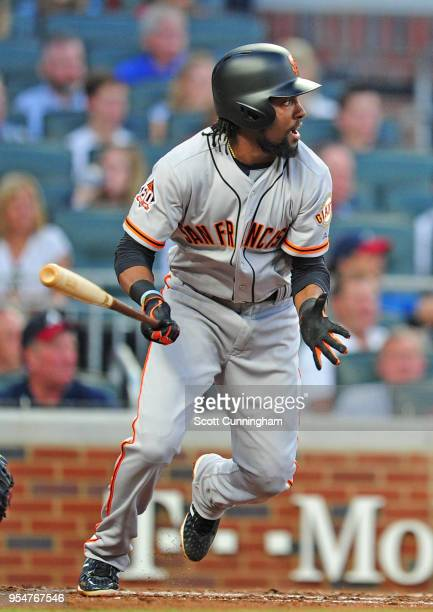 Alen Hanson of the San Francisco Giants hits a second inning double to knock in a run against the Atlanta Braves at SunTrust Park on May 4 2018 in...