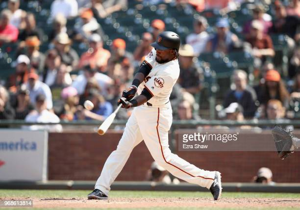 Alen Hanson of the San Francisco Giants hits a tworun home run to tie the game in the bottom of the ninth inning against the Arizona Diamondbacks at...