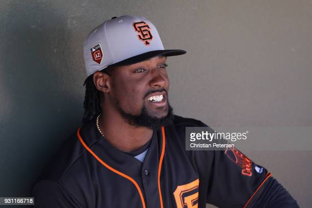 Alen Hanson of the San Francisco Giants in the dugout during the spring training game against the Texas Rangers at Surprise Stadium on March 5 2018...
