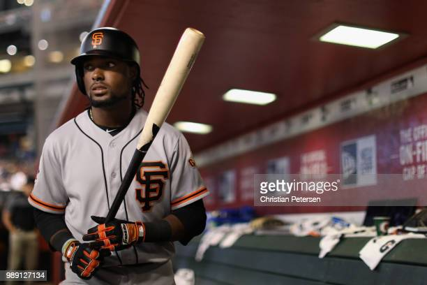 Alen Hanson of the San Francisco Giants prepares to bat during the sixth inning of the MLB game against the Arizona Diamondbacks at Chase Field on...