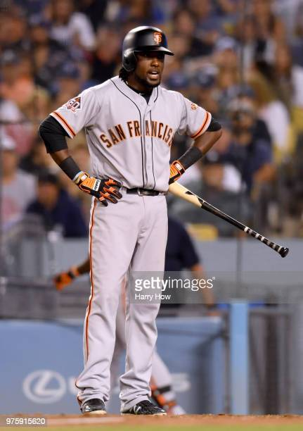 Alen Hanson of the San Francisco Giants reacts as he strikes out looking to end the sixth inning against the Los Angeles Dodgers at Dodger Stadium on...