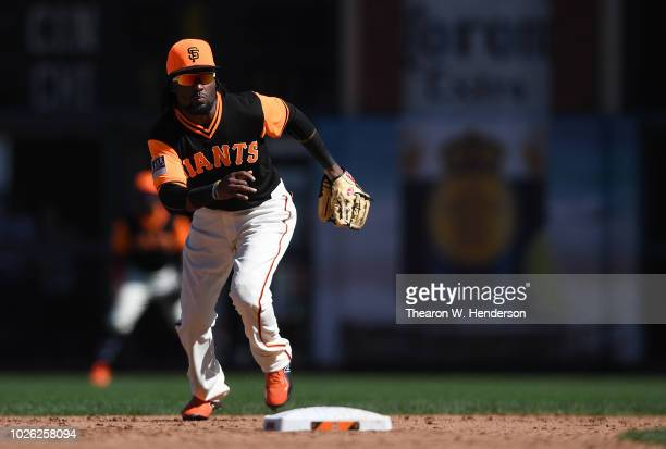 Alen Hanson of the San Francisco Giants reacts to cover second base against the Texas Rangers in the top of the ninth inning at ATT Park on August 25...