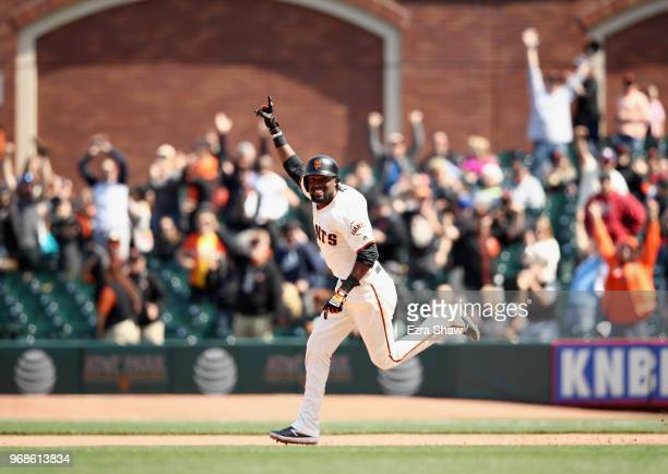 Alen Hanson of the San Francisco Giants rounds the bases after he hit a tworun home run to tie the game in the bottom of the ninth inning against the...