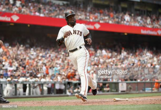Alen Hanson of the San Francisco Giants runs home to score on a hit by Brandon Belt in the eighth inning against the St Louis Cardinals at ATT Park...