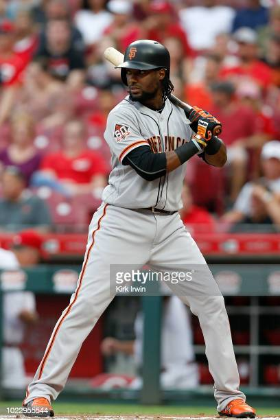 Alen Hanson of the San Francisco Giants takes an at bat during the game against the Cincinnati Reds at Great American Ball Park on August 17 2018 in...