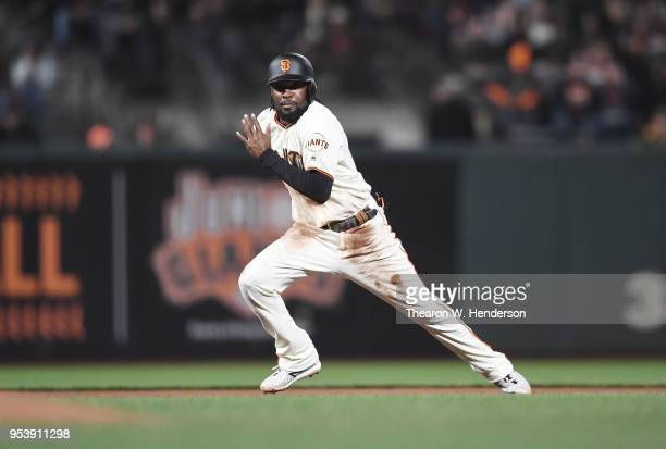 Alen Hanson of the San Francisco Giants takes off from second base attempting to steal third base against the San Diego Padres in the bottom of the...