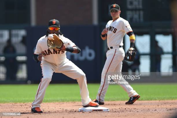 Alen Hanson of the San Francisco Giants turns a double play against the New York Mets during their MLB game at ATT Park on September 1 2018 in San...
