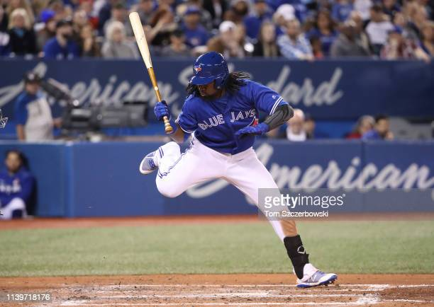Alen Hanson of the Toronto Blue Jays gets out of the way of a low and inside pitch in the fourth inning during MLB game action against the Oakland...