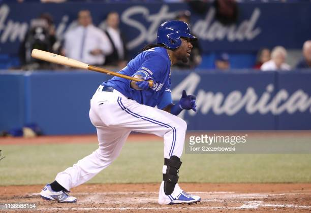 Alen Hanson of the Toronto Blue Jays hits an RBI single in the seventh inning during MLB game action against the Tampa Bay Rays at Rogers Centre on...