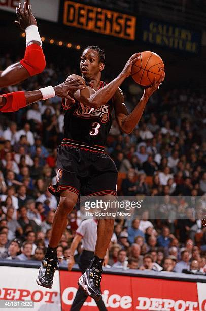 Alen Iverson of the Philadelphia 76ers looks for an open pass during the game against the Houston Rockets on November 12 1997 at the Compaq Center in...
