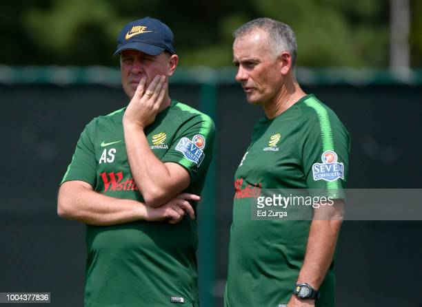 Alen Stajcic head coach of Australia and assistant coach Gary van Egmond watch over players during a training session for an upcoming match in the...