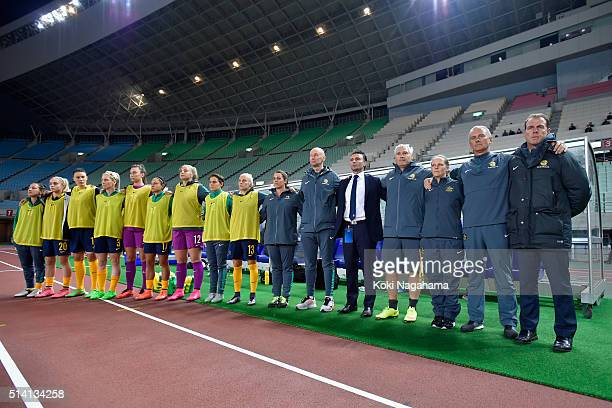 Alen Stajcic head coach of Australia and staffs substitute players line up for the national anthem prior to the AFC Women's Olympic Final...
