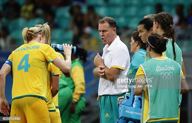 Alen Stajcic head coach of Austrlia talks with players during the Women's Football match between Austrlia and Zimbabwe on Day 4 of the Rio 2016...