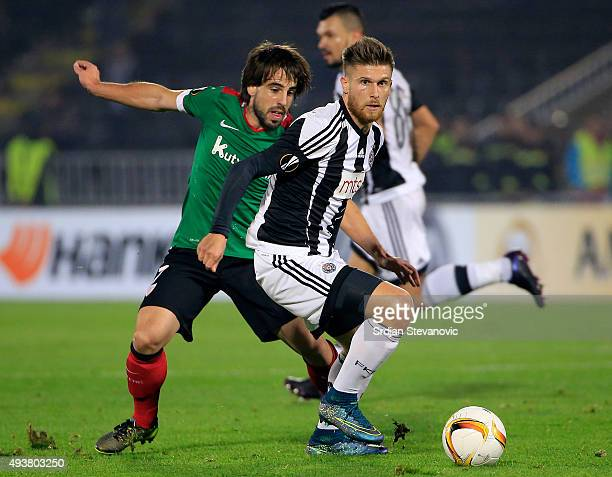 Alen Stevanovic of FC Partizan in action against Benat Etxebarria of Athletic Club during the UEFA Europa League match between FK Partizan v Athletic...