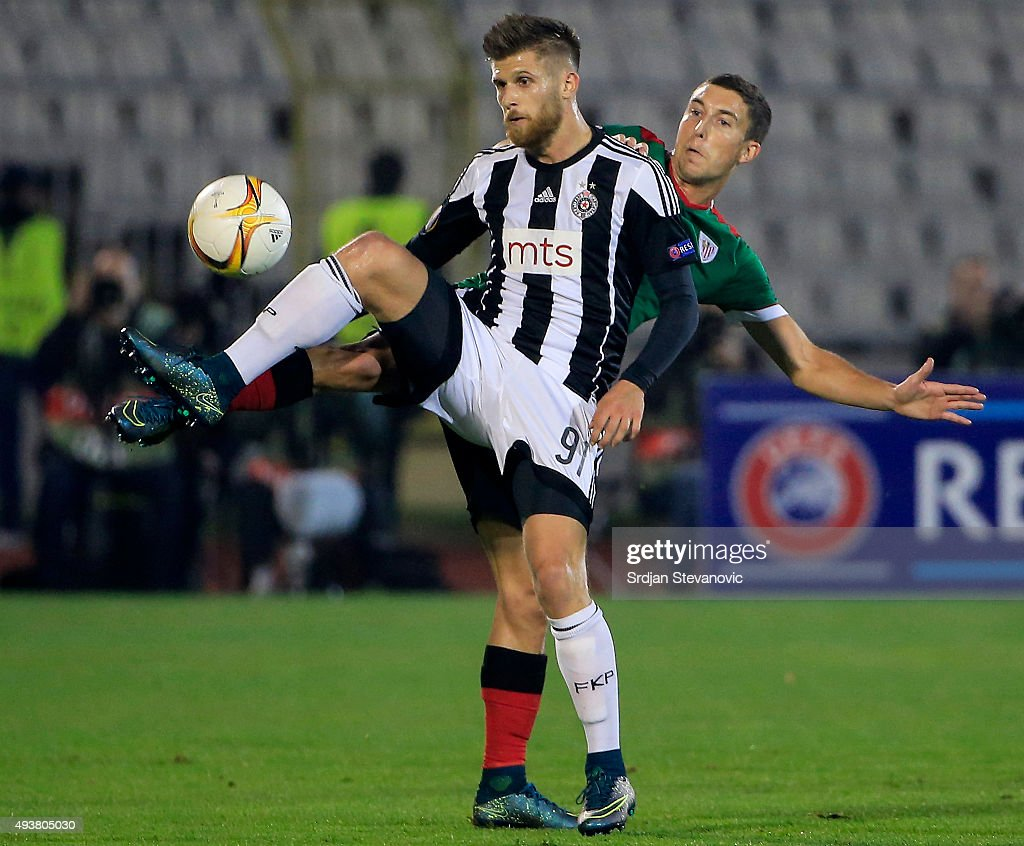 Alen Stevanovic (L) of FC Partizan in action against Oscar de Marcos (R) of Athletic Club during the UEFA Europa League match between FK Partizan v Athletic Club at Stadium FK Partizan on October 22, 2015 in Belgrade, Serbia.