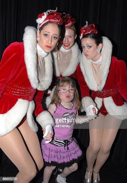 Alena Galan waits with three of the World Famous Radio City Rockettes before her performance at the Garden of Dreams Foundation talent show at Radio...