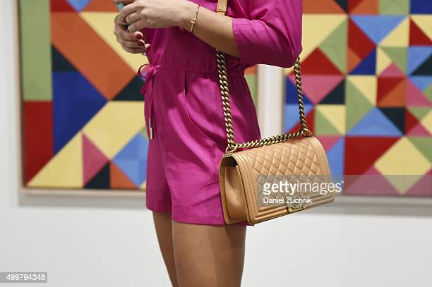 Alena Gavrikova is seen wearing Marciano jumper Gucci shoes and Chanel handbag during Art Basel Miami Beach Vernissage at the Miami Beach Convention...