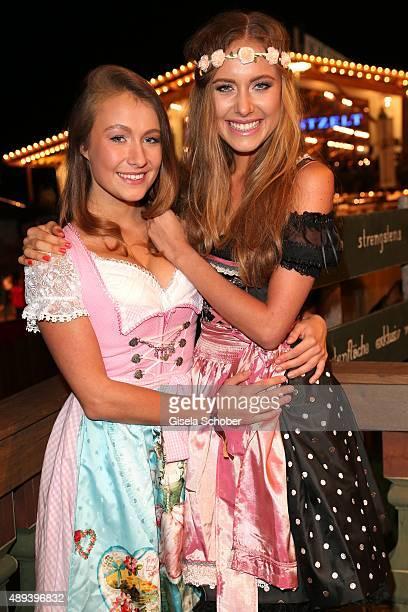 Alena Gerber and her sister Deborah Gerber attend the Almauftrieb during the Oktoberfest 2015 at Kaeferschaenke beer tent on September 20 2015 in...