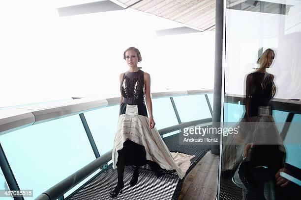 Alena Gerber walks down the catwalk during the Rebekka Ruetz Fashion Show at Top Mountain Star on April 26 2014 at Hochgurgl near Solden Austria