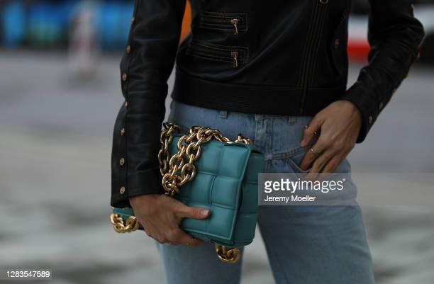 Alena Gerber wearing blue Closed jeans, Bottega Veneta bag and black Versace leather jacket on October 23, 2020 in Hamburg, Germany.