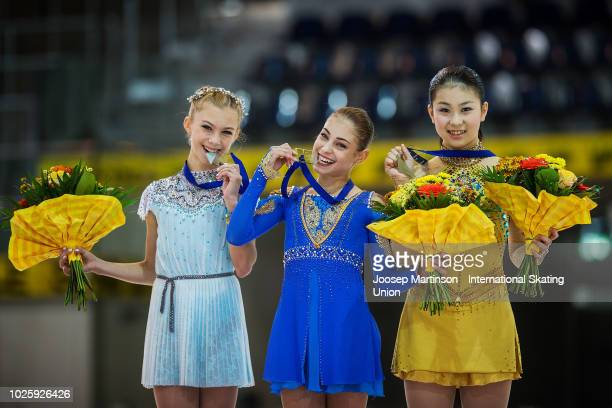 Alena Kanysheva of Russia Alena Kostornaia of Russia and Shiika Yoshioka of Japan pose in the Junior Ladies medal ceremony during day three of the...