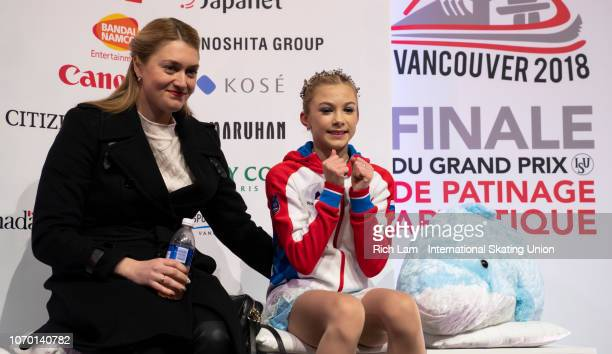 Alena Kanysheva of Russia middle reacts after seeing her score after competing in the Free Skate portion of the Junior Ladies Championships on...