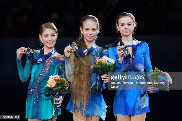 Alena Kostornaia of Russia Alexandra Trusova of Russia and Anastasia Tarakanova of Russia pose with their medals after the Junior ladies free skating...