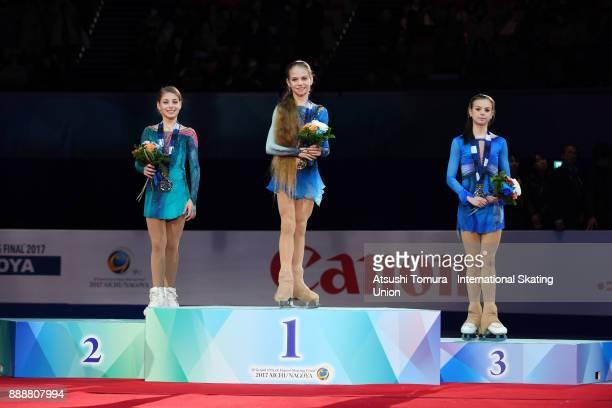 Alena Kostornaia of Russia Alexandra Trusova of Russia and Anastasia Tarakanova of Russia pose on the podium after the Junior ladies free skating...