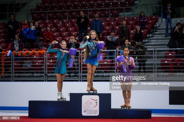 Alena Kostornaia of Russia Alexandra Trusova of Russia and Mako Yamashita of Japan pose in the Junior Ladies medal ceremony during the World Junior...