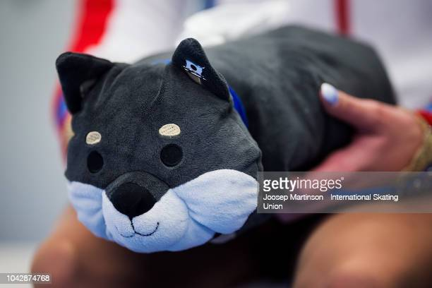 Alena Kostornaia of Russia holds a stuffed animal at the kiss and cry in the Junior Ladies Free Skating during the ISU Junior Grand Prix of Figure...