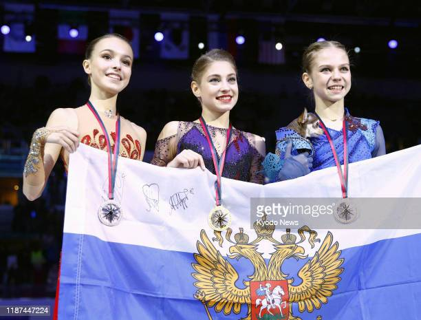 Alena Kostornaia of Russia poses for a photo after winning the Grand Prix Final in Turin Italy on Dec 7 alongside compatriots Anna Shcherbakova and...