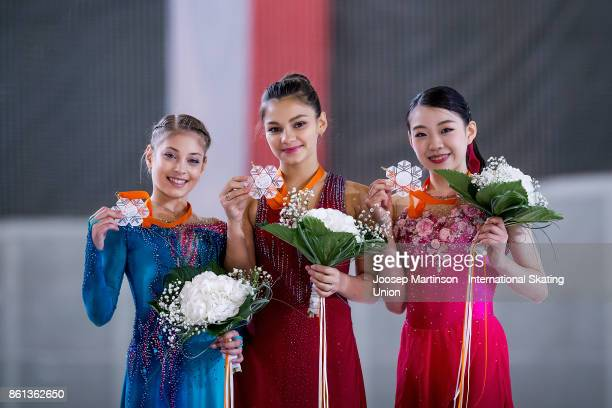 Alena Kostornaia of Russia Sofia Samodurova of Russia and Rika Kihira of Japan pose in the Junior Ladies medal ceremony during day three of the ISU...