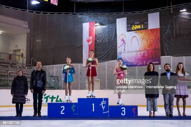 Alena Kostornaia of Russia Sofia Samodurova of Russia and Rika Kihira of Japan pose in the Junior Ladies medal ceremony during day three of the ISU...