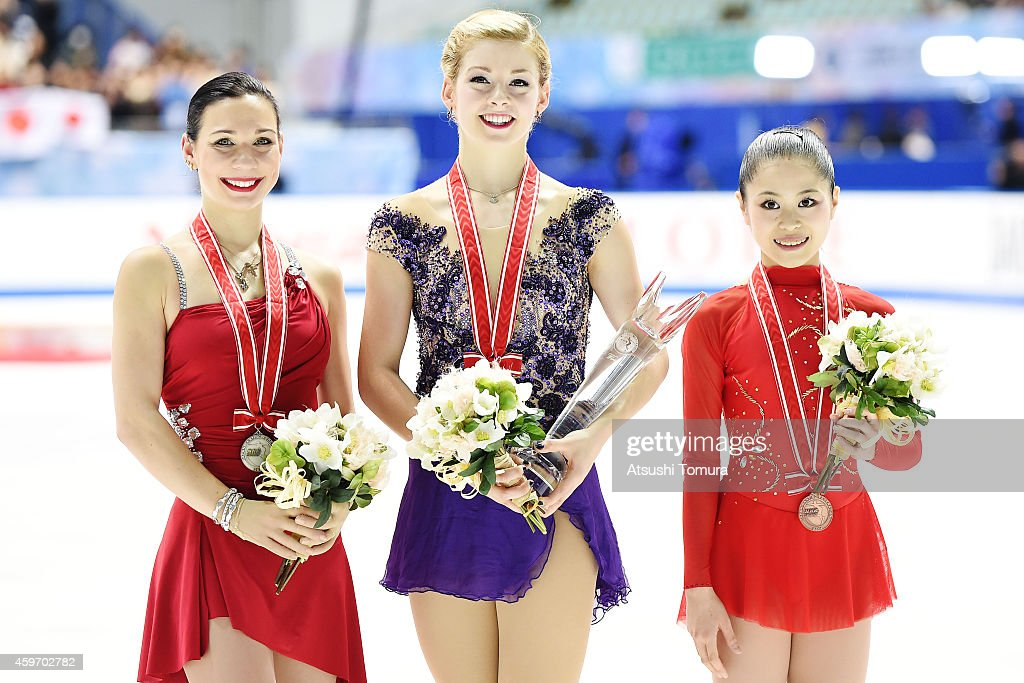 Alena Leonova of Russia (Silver), Gracie Gold of the USA (Gold) and Satoko Miyahara of Japan (Bronze) pose with medal in the victory ceremony during day two of ISU Grand Prix of Figure Skating 2014/2015 NHK Trophy at the Namihaya Dome on November 29, 2014 in Osaka, Japan.