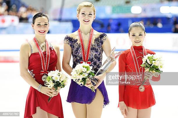 Alena Leonova of Russia Gracie Gold of the USA and Satoko Miyahara of Japan pose with medal in the victory ceremony during day two of ISU Grand Prix...