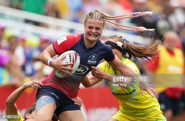 Alena Mikhaltsova of Russia is tackled in the Cup semi final match against Australia during day two of the 2018 Sydney Sevens at Allianz Stadium on...