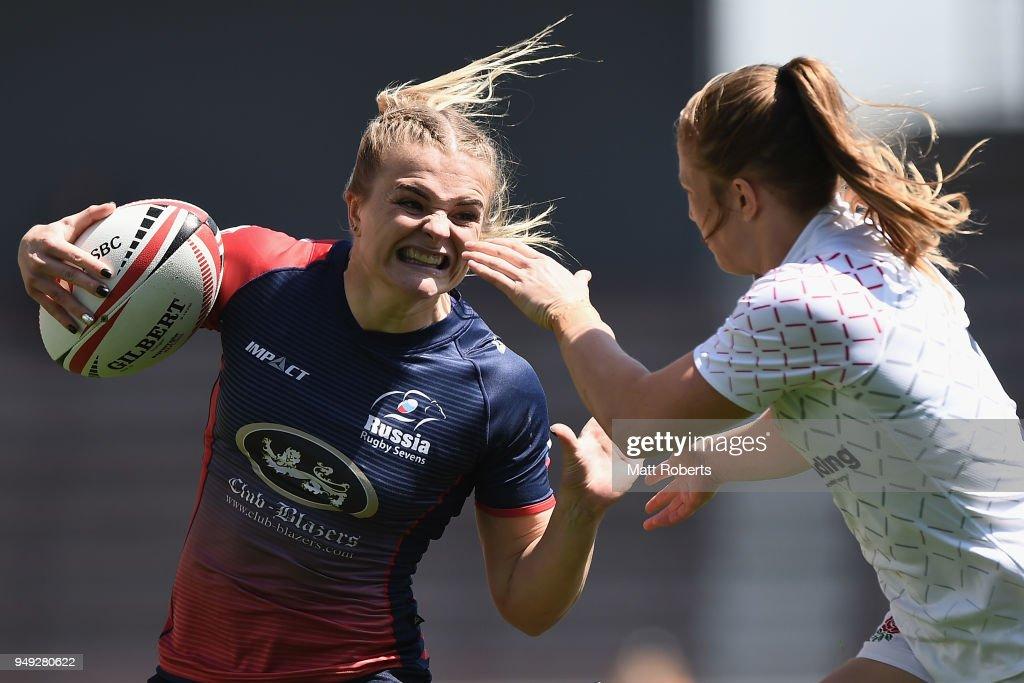 Alena Mikhaltsova of Russia is tackled on day one of the HSBC Women's Rugby Sevens Kitakyushu Pool match between Russia and England at Mikuni World Stadium Kitakyushu on April 21, 2018 in Kitakyushu, Fukuoka, Japan.