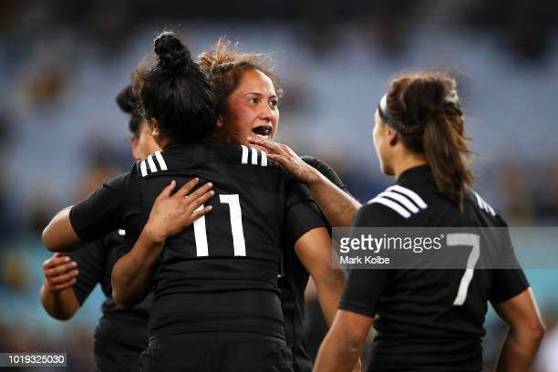 Alena Saili and Aroha Savage of the Black Ferns celebrate victory during the Women's Rugby International match between the Australian Wallaroos and...