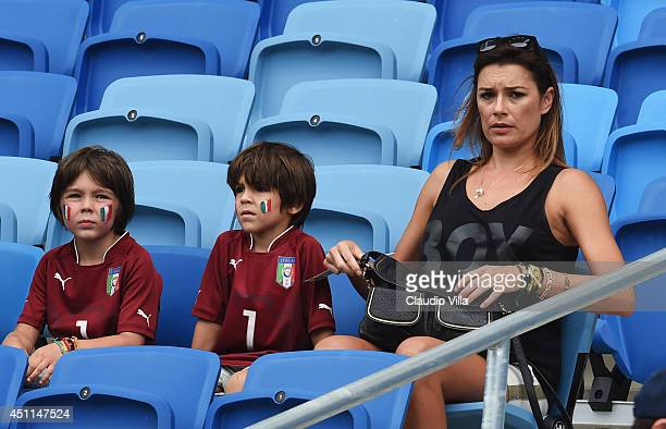 Alena Seredova wife of Gianluigi Buffon of Italy looks on looks on with their sons David and Louis ahead of the 2014 FIFA World Cup Brazil Group D...