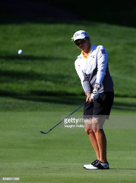 Alena Sharp of Canada chips onto the third green during round one of the Canadian Pacific Women's Open at the Ottawa Hunt Golf Club on August 24 2017...