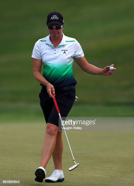 Alena Sharp of Canada reacts after sinking her putt on the 1st hole during the final round of the Manulife LPGA Classic at Whistle Bear Golf Club on...