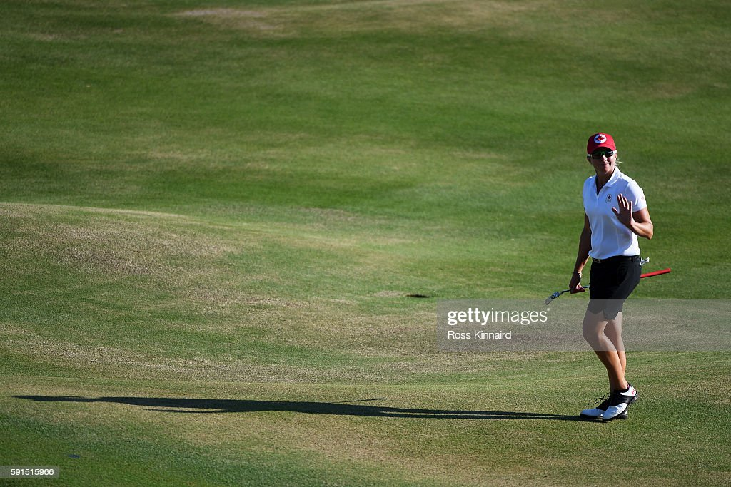 Alena Sharp of Canada reacts on the 18th green during the First Round of Women's Golf at Olympic Golf Course on Day 12 of the Rio 2016 Olympic Games on August 17, 2016 in Rio de Janeiro, Brazil.