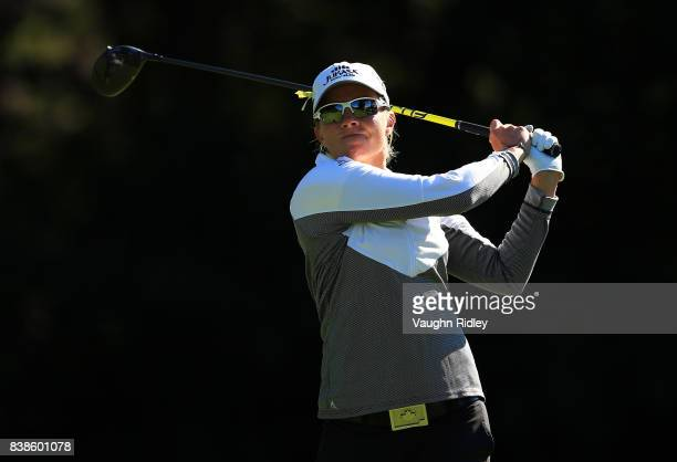 Alena Sharp of Canada watches her shot on the 4th tee during round one of the Canadian Pacific Women's Open at the Ottawa Hunt Golf Club on August 24...