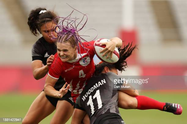 Alena Tiron of Team ROC is tackled in the Women's Quarter Final match between Team New Zealand and Team ROC during the Rugby Sevens on day seven of...