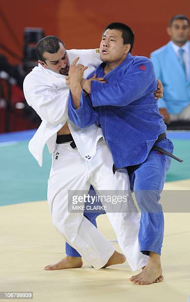 Alenezi Yousef DAJ of Kuwait competes against Shao Ning of China in their men's 100kg bout during day 1 of the Judo competition at the 16th Asian...