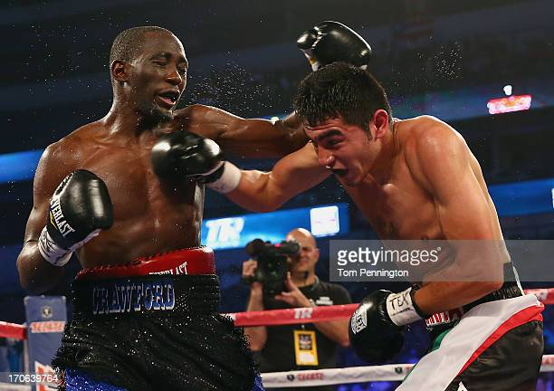 Alenjandro Sanabria lands a right on the face of Terrence Crawford during their NABO Lightweight Title bout at the American Airlines Center on June...