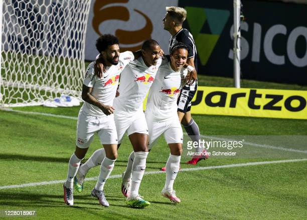 Alerrandro of Red Bull Bragantino celebrates with his teammates Artur and Claudinho after scoring the first goal of his team during the match between...