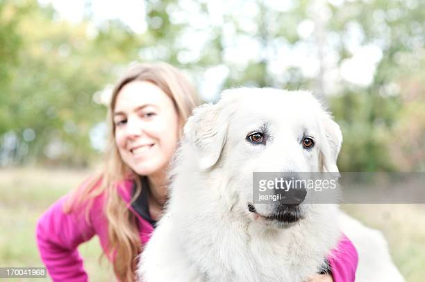 Alert Great Pyrenees with loving owner