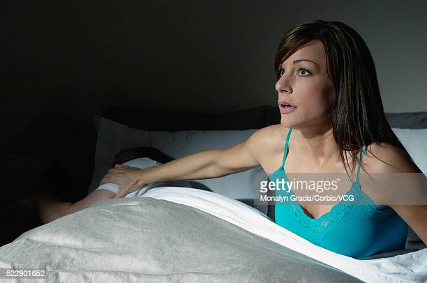 Alert woman waking up her husband during the night