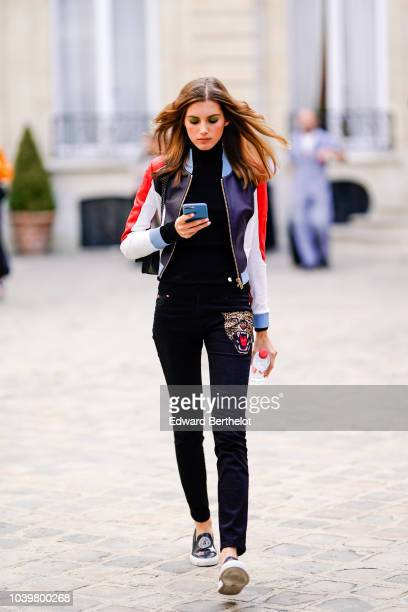 alery Kaufman wears a colored leather jacket outside Jacquemus during Paris Fashion Week Womenswear Spring/Summer 2019 on September 24 2018 in Paris...